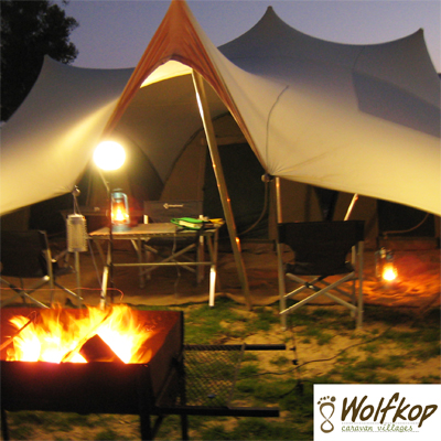 Time for a relaxing break! Experience camping and caravaning around a fire (wood incl) without having to pitch up your own gear in Citrusdal starting at R497 for 4 people per night on edge of river, canoe hire included!