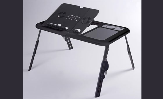 Wonderfully convenient and ergonomic Muiltipurpose Laptop Foldable Table E-Table with dual cooling fans. The perfect device for anyone who works on a laptop away from their desk. Only R299 INCL FREE NATIONAL DELIVERY!
