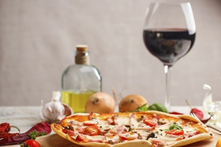 Any Pizza and a Glass of House Wine from R67 at Picassos (Up to 53% Off)