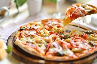 Any Large Pizza at Hendrix Pizza & Coffee Cafe (Up to 55% Off)