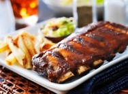 All You Can Eat Ribs, Chips and One Garlic Loaf from R149 at Scrooge Diner