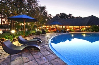 ✈ Victoria Falls: Two or Three-Night Stay Per Person Sharing with Flights, Breakfast & a Cruise at A'Zambezi River Lodge