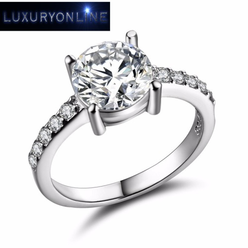 White Gold Filled Ring With 11 0,75ct Simulated Diamonds