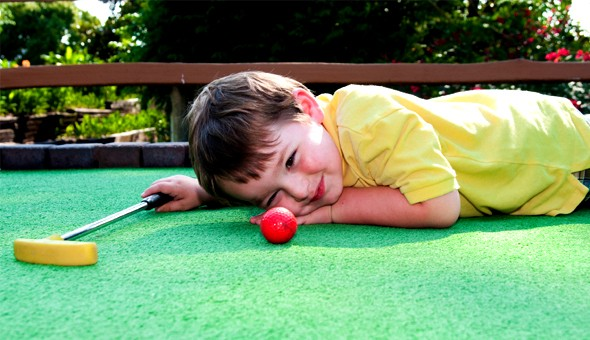 Tee off to fun with a Game for up to 6 People at Cave Golf, V&A Waterfront!