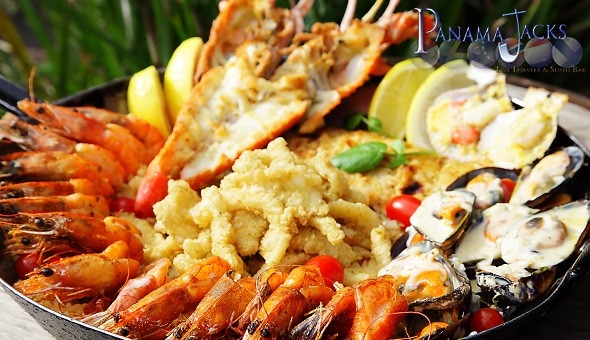 Grilled Lobster, Prawns, Crumbed Calamari, Mussels with Cream Sauce & More! The ultimate Seafood Platter for 2 People at the legendary Panama Jacks!