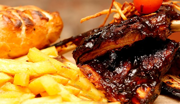 1KG BBQ Beef Ribs with Chips & Garlic Roll for 2 People at The Backyard Grill & Lounge, Sea Point!