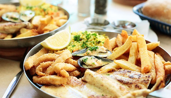 Back by Popular Demand! A Seafood Platter and a Freshly Baked Decadent Malva Pudding with Custard & Ice-cream for 1 Person for only R89 at Hooked, Tyger Valley Shopping Centre!
