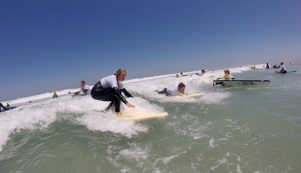 Blouberg: Surf, Burgers & Waffles for 2 People (adults or kids)! Includes: 90 Minute Surf Lessons with Gear, Gourmet Burgers with Fries and Waffles with Ice-cream!