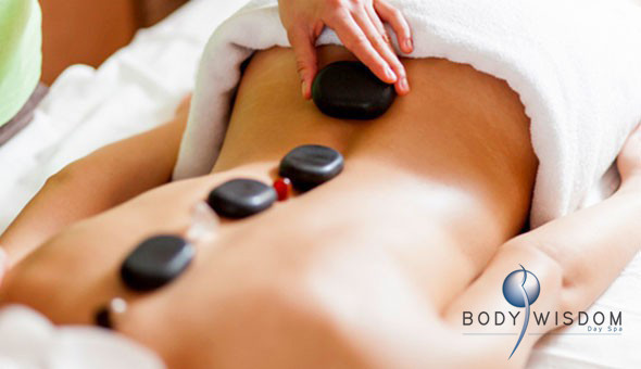 A Full Body Hot Stone or Swedish Massage at Body Wisdom, located on Blaauwberg Road in Table View!