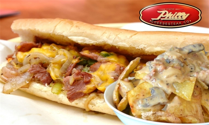 Rib-eye Cheesesteak with Potato skins drenched in a Bacon and Mushroom cheese sauce from R79 at Philly Cheesesteak Lonehill