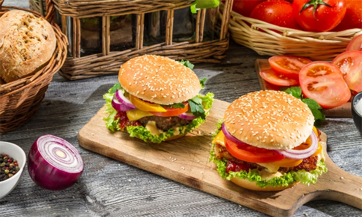 Two Signature TMD Beef or Chicken Burger with Side Portion of Wedges and Sauce for R99 at The Market Deli