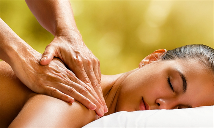 60-Minute Full Body Swedish Massage with Optional Express Facial & Honey Back Scrub at Wax in the City