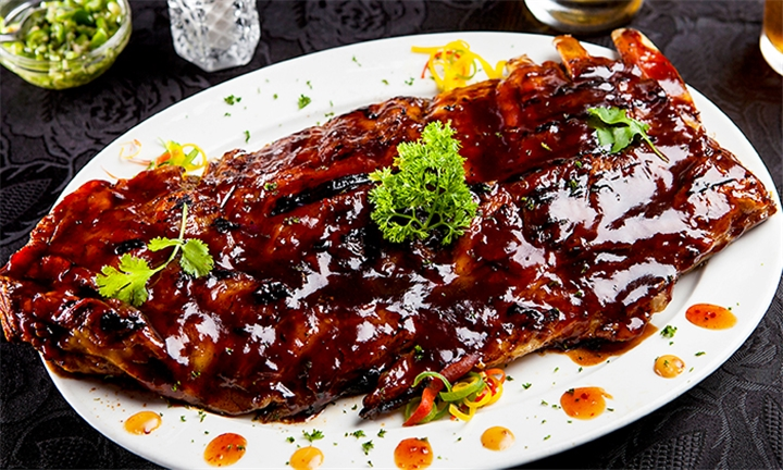 600g Succulent Pork Ribs with Chips and Bottle of Wine for Two at Vini's Restaurant