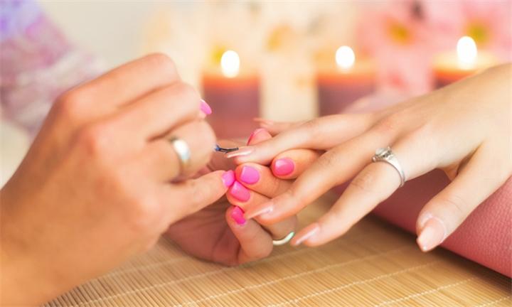 Choice of Gelish Manicue or Pedicure at Thida Massage & Spa