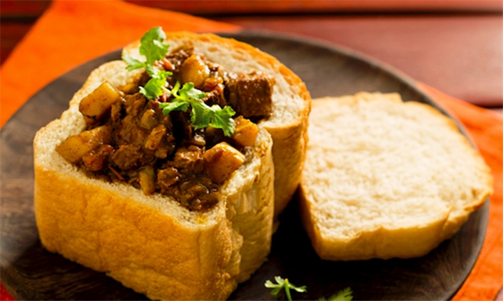 Choice of Bunny Chow or Curry Each for up to Four at The Purple Lounge