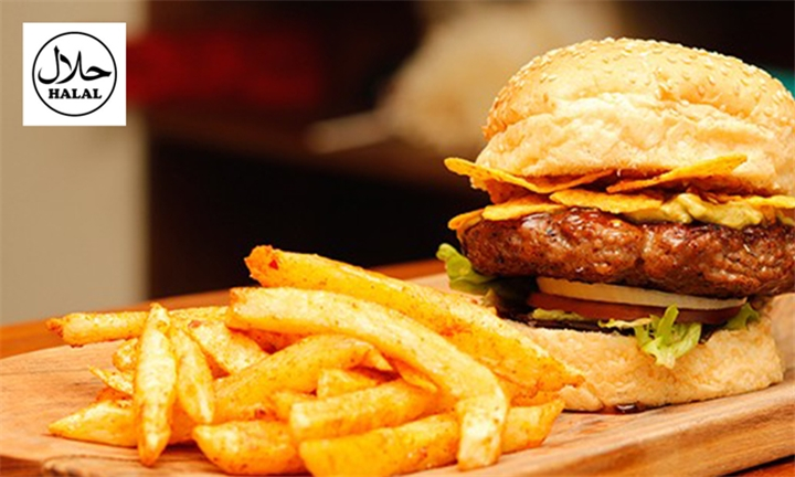 King Feast: Chicken Wings and Choice of Gourmet Burgers with Fries Each for up to Four at King of the Grill