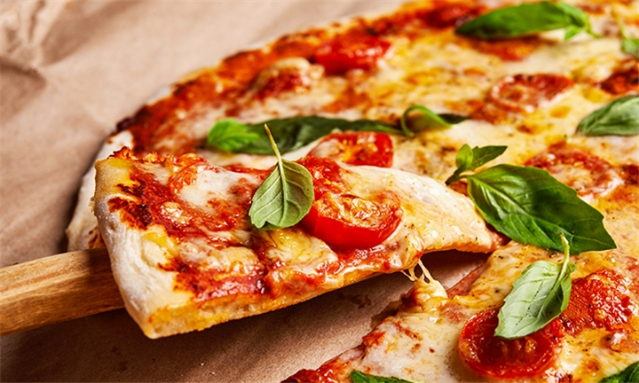 Weekday Special: Choice of 2 Gourmet Pizzas for at MonkeyBluz Restaurant & Cocktail Bar