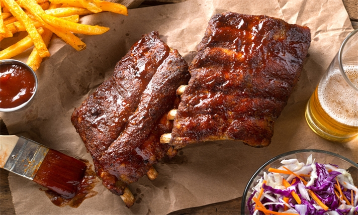 Choice of 600g Hot-Smoked Beef or Pork Ribs with Fries & Slaw each for up to Four at Lefty's