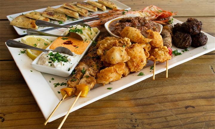 Greek Meze Platter for up to Four with a Bottle of Wine at Simply Greek Stellenbosch