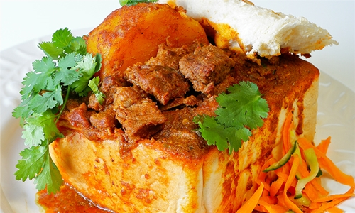 Authentic Durban Mutton Curry Bunny Chow with Salad with Delivery from Imperial Gardens Restaurant