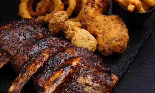 Pick-Up: Rib and Wing Combo Including Chips and Onion Rings from La Rocca