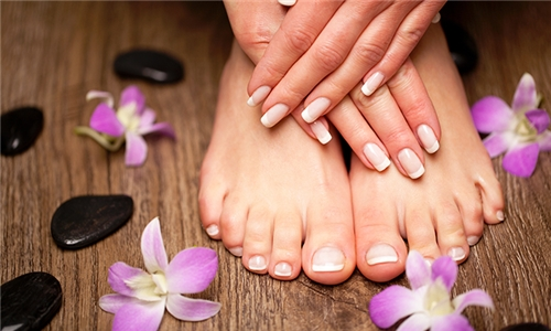 Express Mani and/or Pedi from Solutions Spa