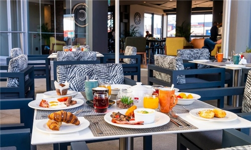 Breakfast Special with Complimentary Hot Beverage at The Canal Café at aha Harbour Bridge Hotel & Suites