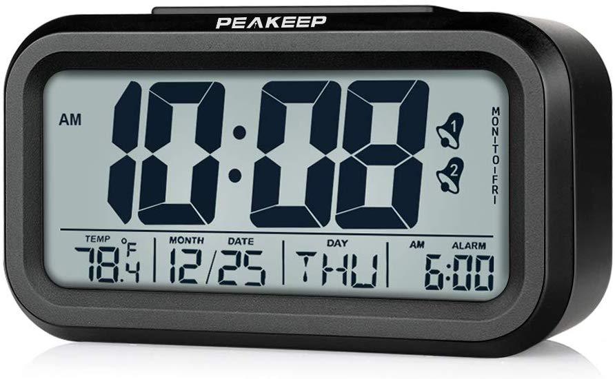 Peakeep Battery Operated Cordless Digital Dual Alarm Clock, 7-6-5-day Programmable Alarm, Calendar, Indoor Temperature, Smart Sensor Light (Black)