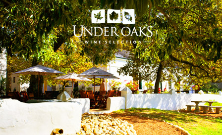 Savour an exquisite tasting of 4 award-winning wines for R69 PLUS a delicious cheese platter for 2 at Under Oaks in Paarl