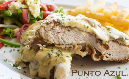 Savour a crumbed beef or chicken schnitzel with a decadent sauce and sides for only R99 for 2 people at Punto Azul, Strand